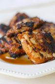 picture of chipotle  - Several spicy chipotle apricot BBQ chicken thighs.
