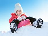 foto of sled  - Girl with sleds on the hill against the blue sky - JPG