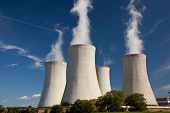 stock photo of exhale  - Sreaming cooling tower at nuclear power plant - JPG