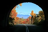 stock photo of blue ridge mountains  - View of distant mountains in autumn through tunnel on Blue Ridge Parkway North Carolina - JPG