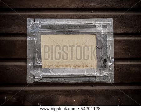 Blank white sign board framed by gaffer tape on wall background