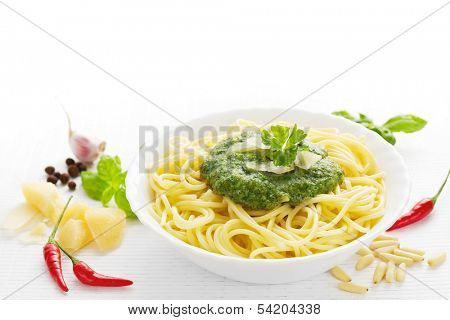 Spaghetti with spicy pesto and ingredients