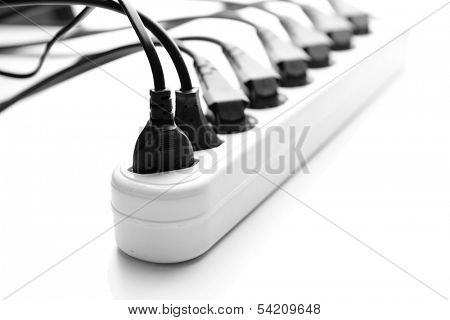 Overloaded power board, isolated on white