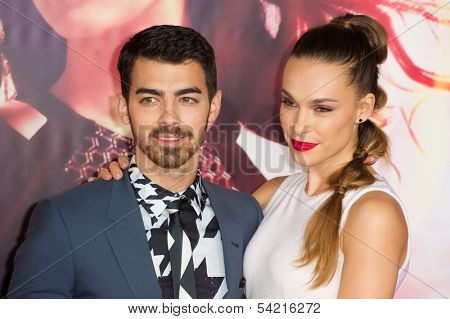 LOS ANGELES, CA - NOVEMBER 18: Singer Joe Jonas and Model Blanda Eggenschwiler arrive at the premiere of The Hunger Games: Catching Fire at the Nokia Theater in Los Angeles, CA on November 18, 2013