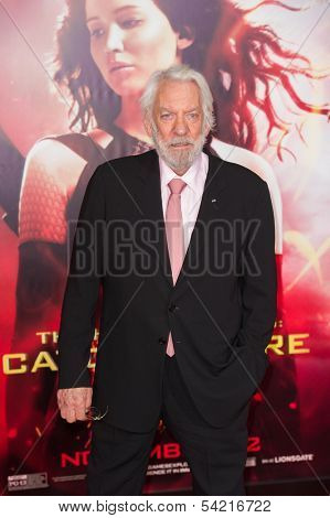 LOS ANGELES, CA - NOVEMBER 18: Actor Donald Sutherland arrives at the premiere of The Hunger Games: Catching Fire at the Nokia Theater in Los Angeles, CA on November 18, 2013