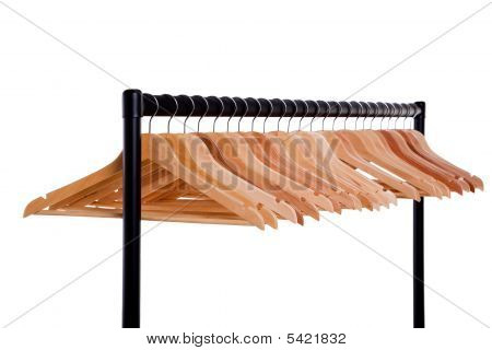 Clothes Rail And Wooden Hangers Isolated On White