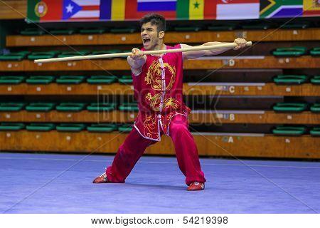 KUALA LUMPUR - NOV 03: Iran's Farshad Arabi performs with a staff in the Men's 'Nangun' Event at the 12th World Wushu Championship on November 03, 2013 in Kuala Lumpur, Malaysia.
