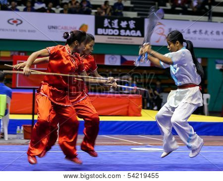 KUALA LUMPUR - NOV 05: Members of Indian dalian team performs a fight scene in the Women's Dual Event at the 12th World Wushu Championship on November 05, 2013 in Kuala Lumpur, Malaysia.