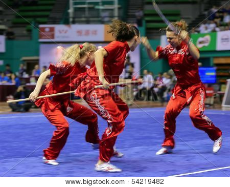KUALA LUMPUR - NOV 05: Members of Ukraine's dalian team performs a fight scene in the Women's Dual Event at the 12th World Wushu Championship on November 05, 2013 in Kuala Lumpur, Malaysia.