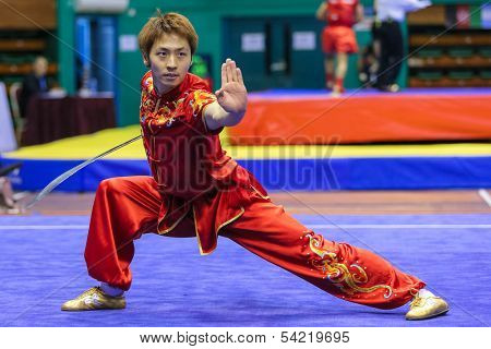 KUALA LUMPUR - NOV 03: South Korea's Jo Kyeyong performs with a staff in the Men's 'Nangun' Event at the 12th World Wushu Championship on November 03, 2013 in Kuala Lumpur, Malaysia.