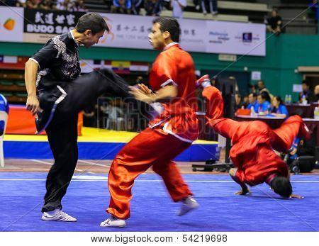KUALA LUMPUR - NOV 05: Members of India's dalian team performs a fight scene in the Men's Dual Event at the 12th World Wushu Championship on November 05, 2013 in Kuala Lumpur, Malaysia.