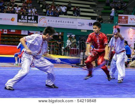 KUALA LUMPUR - NOV 05: Members of Philippine's dalian team performs a fight scene in the Men's Dual Event at the 12th World Wushu Championship on November 05, 2013 in Kuala Lumpur, Malaysia.