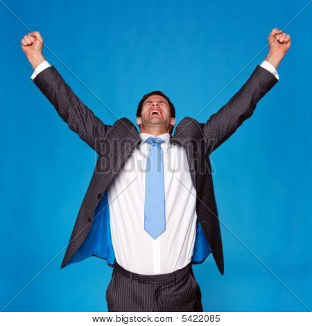Businessman Celebrating With Arms Raised In The Air