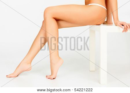 Beautiful female legs, white background