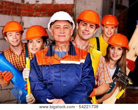 Happy group people in builder uniform.
