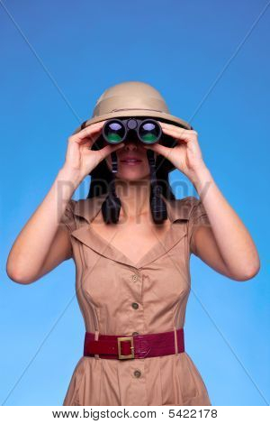 Woman In Safari Hat Looking Through Binoculars