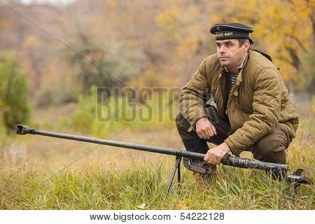 DNIPRODZERZHYNSK, UKRAINE - OCTOBER 26 : Member of battle Historical reenactment shows anti-tank gun