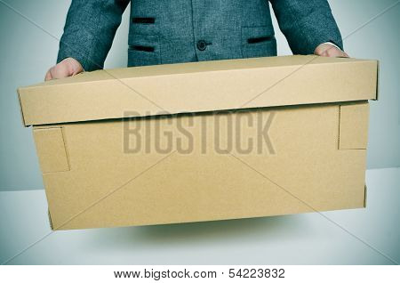 a businessman carrying a box, leaving or moving to a new office