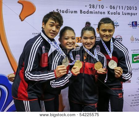 KUALA LUMPUR - NOV 03: Members of the Malaysian Wushu team show off their medals after the Presentation Ceremony at the 12th World Wushu Championship on November 03, 2013 in Kuala Lumpur, Malaysia.