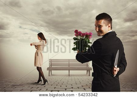 cunning man going to meeting and holding flowers and knife