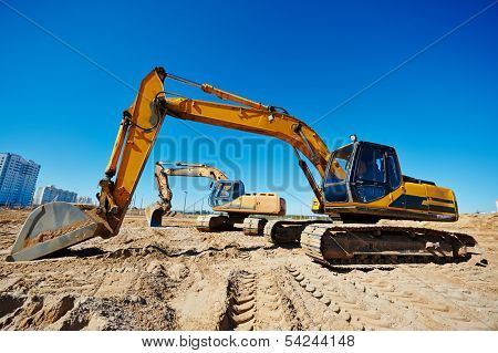 Two track-type loader excavator machine at earthmoving work in sand quarry