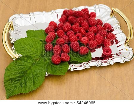 Raspberries Are On A Metal Tray