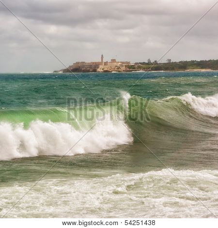 The castle of El Morro with big sea waves in the foreground during a tropical cyclone in Havana