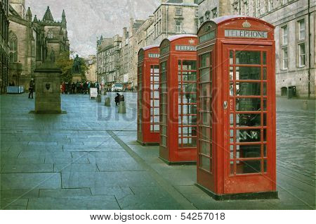 Three red booths on a row in the street at Edinburgh, Scotland, UK.  Vintage and retro style.