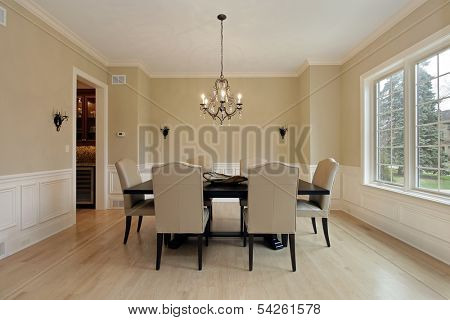 Dining room in luxury home with candle sconces