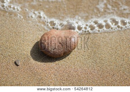 Single Pebble On The Beach