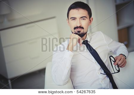 Portrait of posh guy in formalwear looking at camera