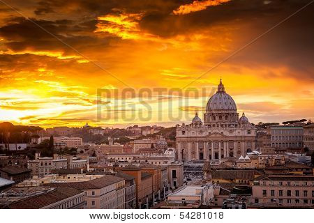 Sunset over St. Peter's cathedral in Rome, Italy