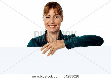 Cheerful Woman Holding Blank Ad Board