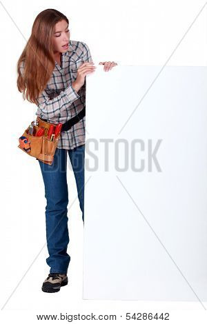 Female manual worker with a blank board
