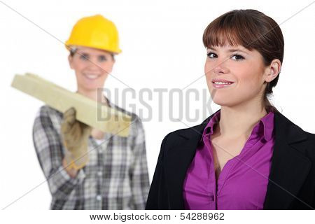 craftswoman and young businessman posing together