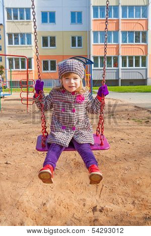 sympathetic child on the swings