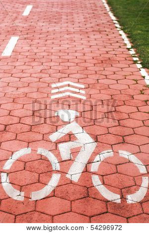Bicycle symbol on a red bike path