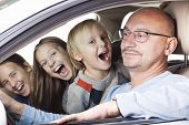 Happy Father With Children In The Car