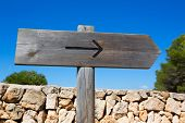 Arrow wooden track blank road sign in Mediterranean Balearic islands