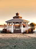 stock photo of gazebo  - gazebo with footprints on frost covered grass - JPG