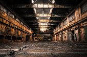 stock photo of messy  - Old Abandoned Industrial Interior With Bright Light - JPG