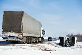 stock photo of lorries  - Lorry trailer car crash smash accident on an slippery winter snow interstate road - JPG