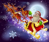 picture of rudolf  - A Santa Claus sleigh Christmas scene of Santa Claus flying through the air on his sled being pulled by reindeer with snowflakes and full moon - JPG