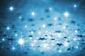 picture of glitter sparkle  - Abstract image of blue winter background with stars - JPG