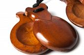 stock photo of castanets  - one pair of Spanish Castanets on white background - JPG