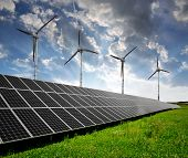 stock photo of windmills  - solar energy panels and wind turbines - JPG