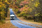 foto of twisty  - Winding asphalt road with autumn foliage  - JPG