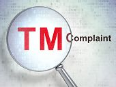 Law concept: Trademark and Complaint with optical glass