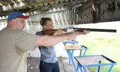 pic of shooting-range  - The instructor the man trains the woman - JPG