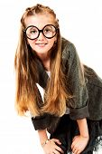 Portrait of a pretty ten years girl in big round spectacles. Isolated over white.